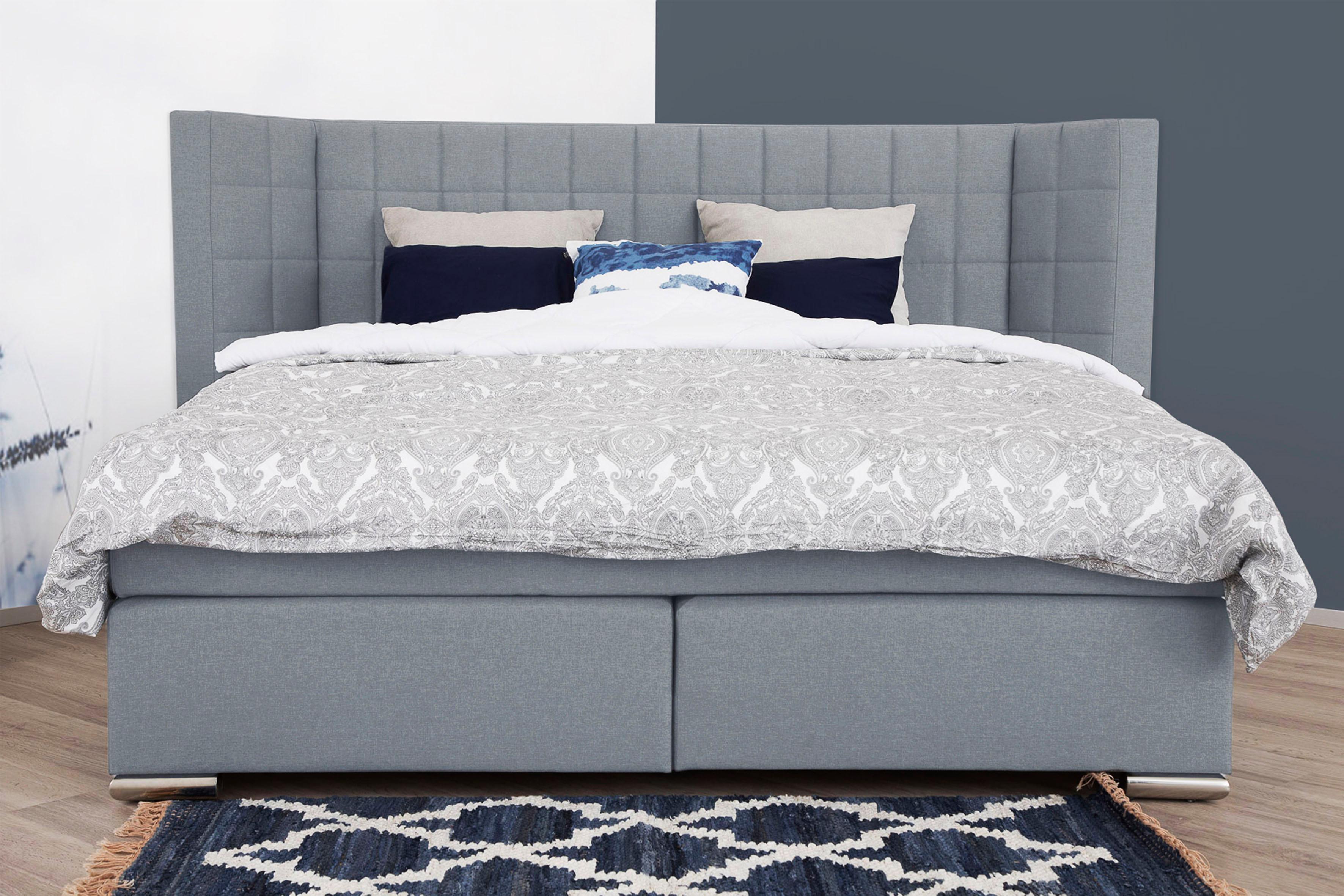 places of style boxspringbett piazza mit steppung und kopfteil mit seitlichen fl geln auf. Black Bedroom Furniture Sets. Home Design Ideas